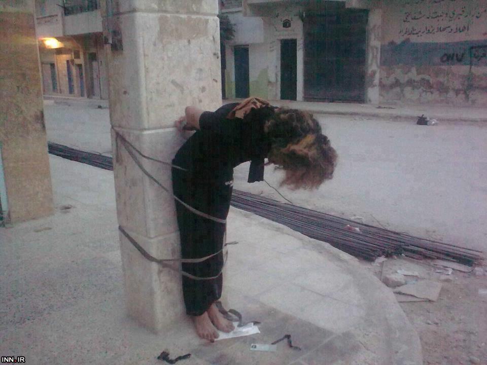 عکس / قتل فجیع یک زن توسط ترویست های سوری 18+